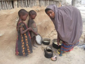 Preparing food in Somalia famine.
