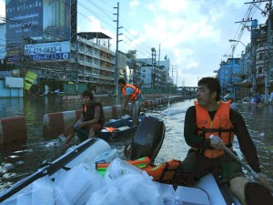 World Concern staff distributes food in Thailand floods.