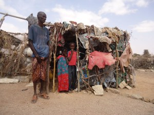 A father with his children outside their home in Somaliland.