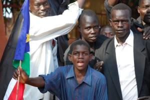 South Sudan boy with flag.
