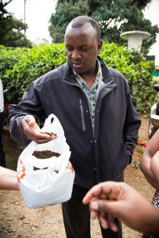 Peter looks at fertilizer during a World Concern farming training.