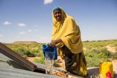 Asha receives clean water in her Somali village