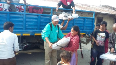 A woman receives emergency supplies from World Concern in Bhotechaur.