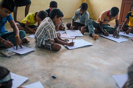 Children in Sri Lanka draw pictures to express their feelings in our program.