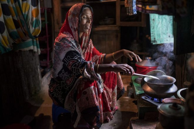 a woman cooks a meal in Bangladesh