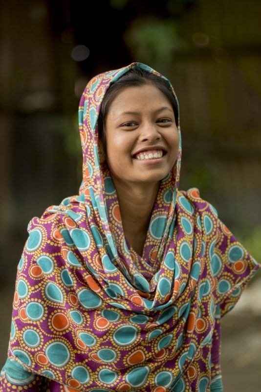 a girl receives education in Bangladesh