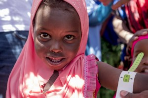 a little girl measures as healthy after receiving emergency nutrition