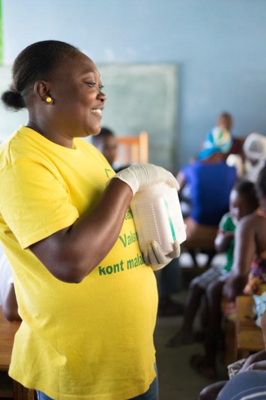 A nurse in haiti distributes deworming medicine