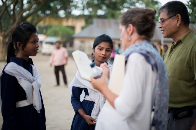 interviewing girls who received scholarships in Bangladesh