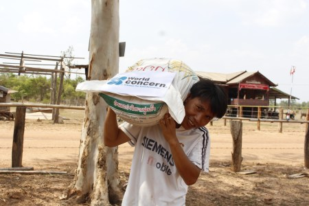 Farmer carrying rice seed.