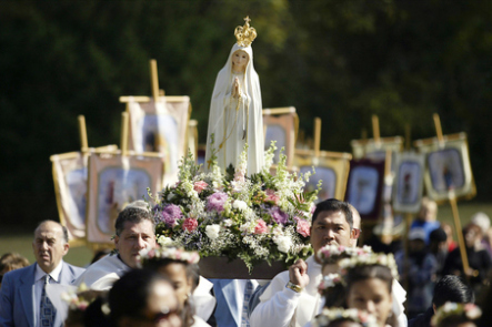 20071012TB 1/x Our Lady of Fatima is carried during the Rosary Procession on the Blue Army Shrine Grounds, during the 90th anniversary celebration of the apparitions of Fatima. PHOTO BY TYLER BARRICK / FOR THE STAR-LEDGER