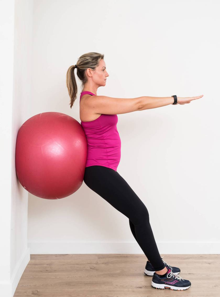 Stability ball squat first trimester exercise