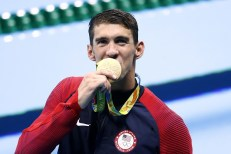 Phelps with gold medal taper