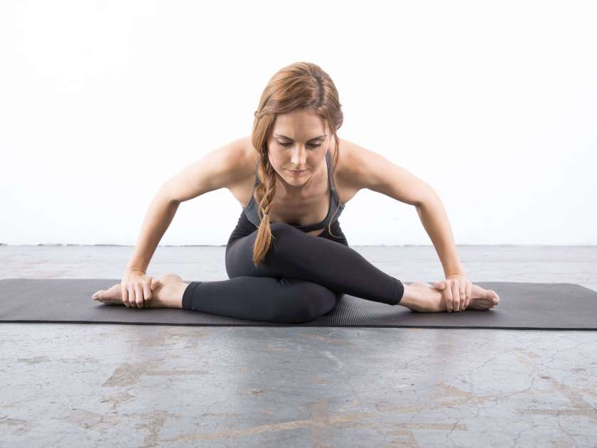 Shoelace pose: yin yoga poses for the shoulders