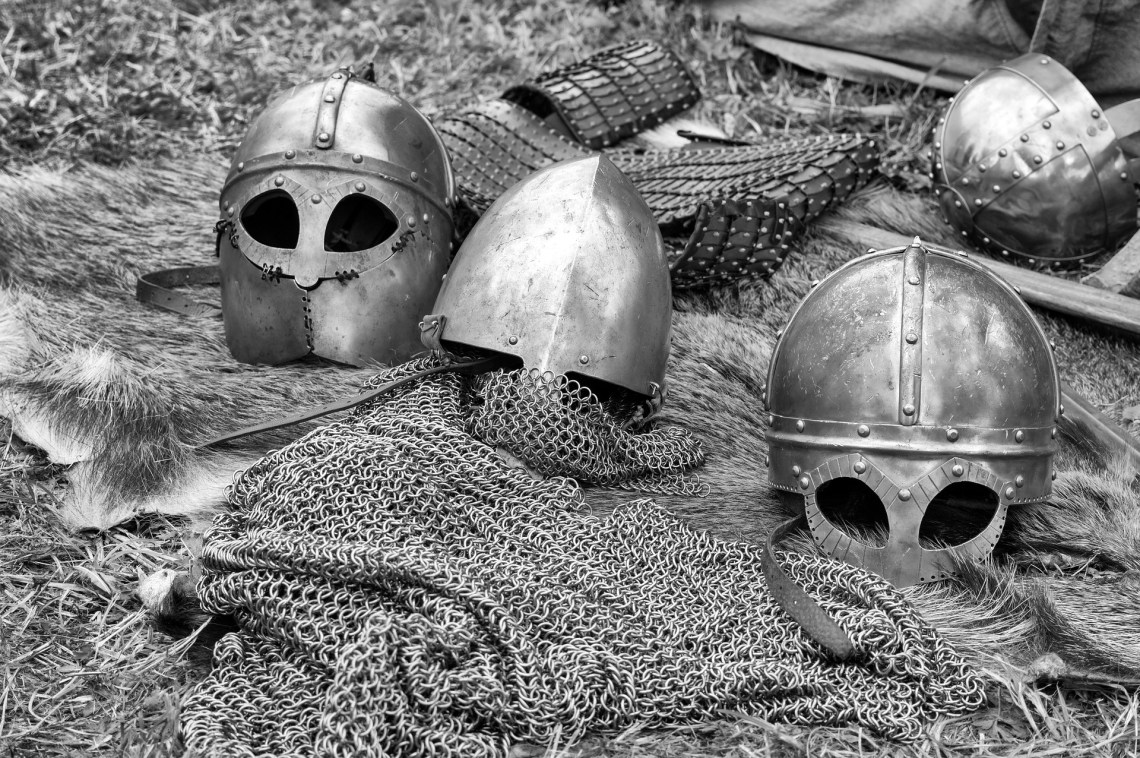 various pieces of armour sitting on top of chain mail
