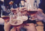 many glasses of wine and beer toasting