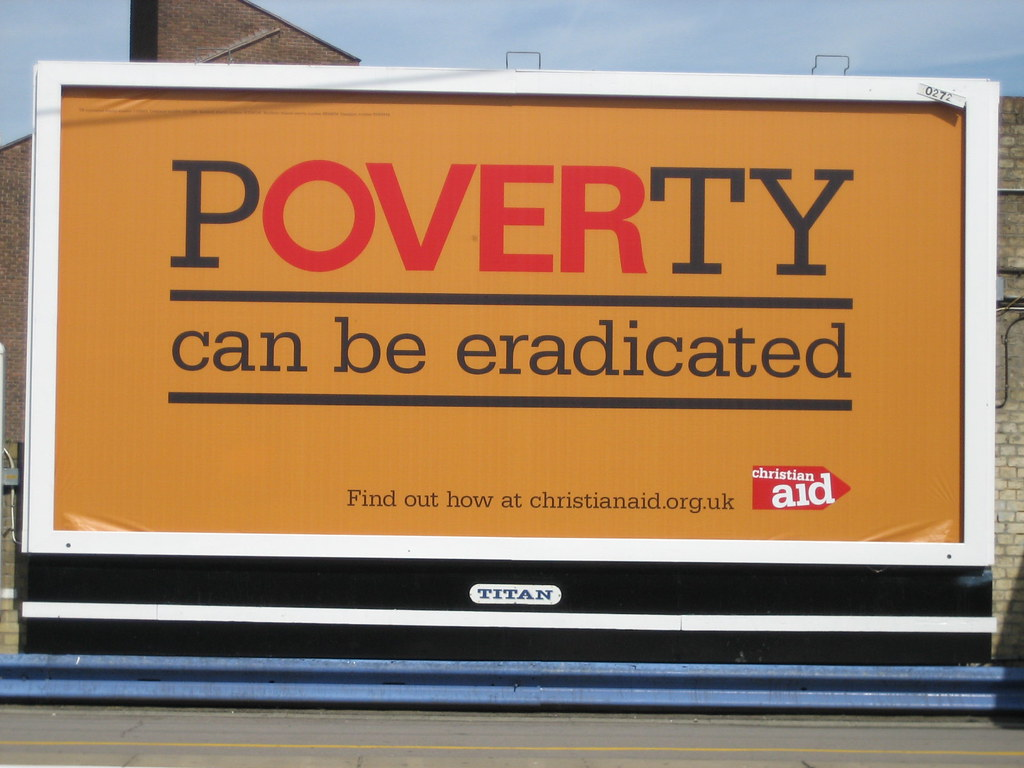billboard stating poverty can be eradicated