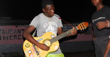 refugee playing a guitar in Tongogara refugee camp