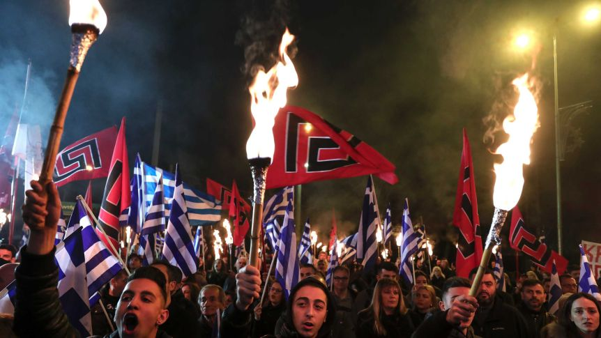 members of greece's golden dawn protesting at night