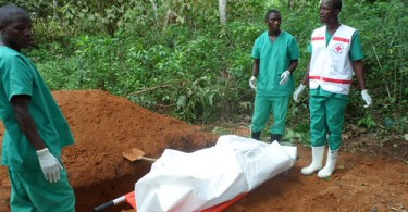 west african medics prepare ebola victim for burial