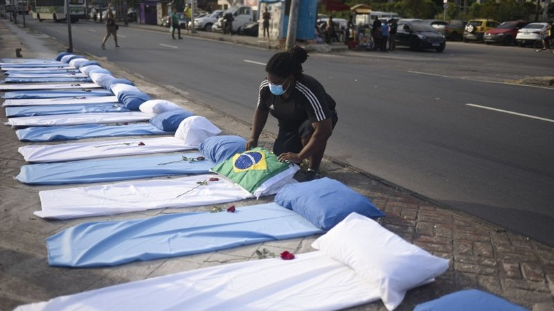 beds laid out on street outside rio hospital