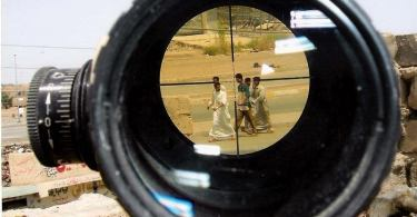 image from sniper scope of young afghans