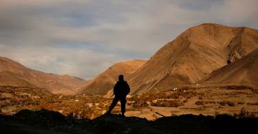 fighter standing in Afghan valley