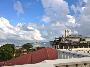 View of Stone Town harbor from hotel terrace.