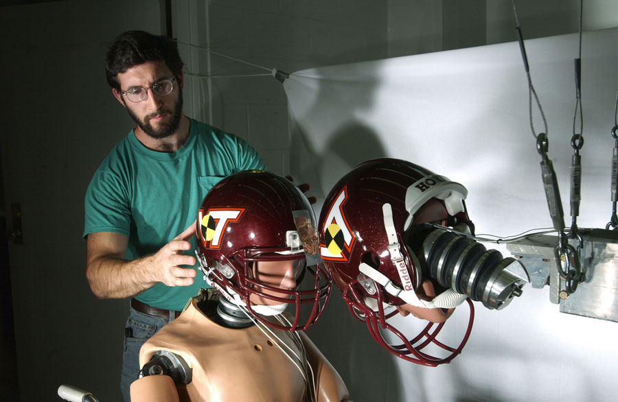 Personnel in the Center for Injury Biomechanics Laboratory at Virginia Tech study biomechanics innovations on helmets of football players