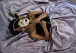 Person laying on bed with a mask
