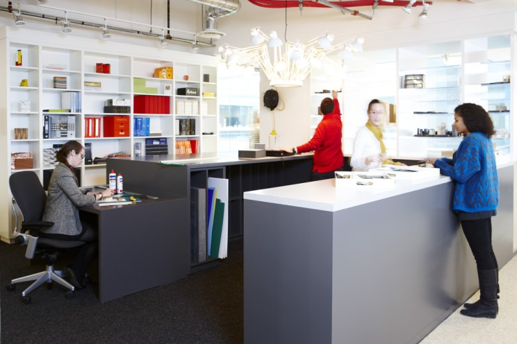 four women use the model making and materials library section at Quadrangle's studio