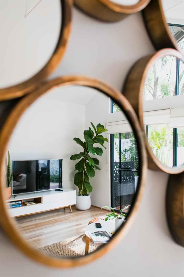 mirrors reflecting interior of modern lounge
