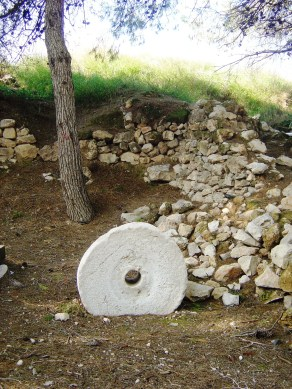 A Millstone, resting in the earth