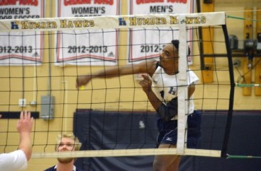 PHOTO BY GEORGE HALIM Andre Smith spikes one of his team's 34 kills in the Dec. 1 home win over College Boreal.