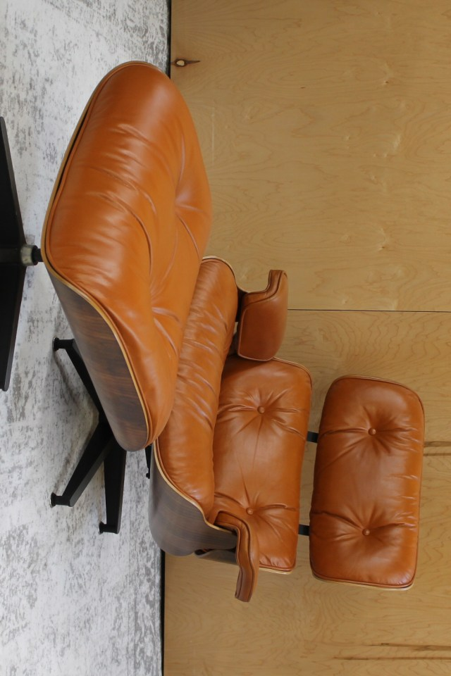 classic eames lounge and ottoman in burnt orange leather