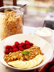 Peanut Butter Granola with raspberries and bananas