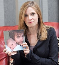 Louise holding a picture of Neil and Oscar