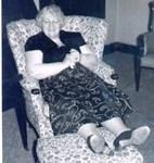 Aunt Philomena's feet on their favorite ottoman.