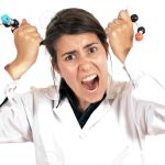 9642693-young-female-laboratory-technician-working-with-a-molecule