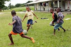 Image result for kids playing soccer in third world