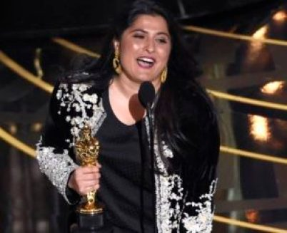 """Sharmeen Obaid-Chinoy accepts the award for best documentary short for """"A Girl in the River: The Price of Forgiveness"""" at the Oscars on Sunday, Feb. 28, 2016, at the Dolby Theatre in Los Angeles. (Photo by Chris Pizzello/Invision/AP)"""