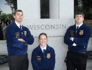 Official Dress: A group of my FFA friends went to the Washington Leadership Conference. Here we are siting in front of Wisconsin at the World War 2 memorial. By the way, those blue jackets are made out of cotton.
