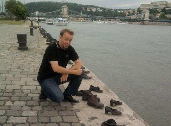 Gergely Kulcsár, Jobbik member of parliament, posing after he spat into one of the shoes