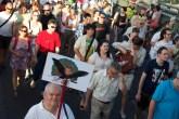 Demonstrators march across the Chain Bridge.