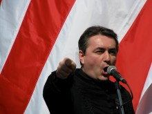 Reformed pastor Loránt Hegedűs Jr. speaks in front of an Árpád-Striped Flag during an anti-government rally on the March 15 national holiday (5/15/2008).