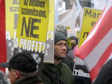"Trade union demonstrator holding sign proclaiming ""Let People Count, Not Profit!"" (12/15/2007)"