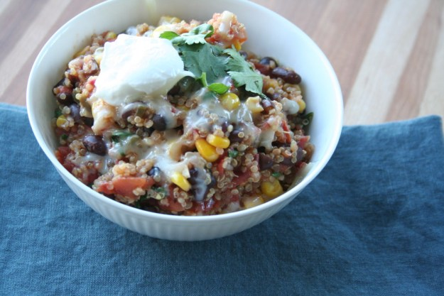 close up of delicious Mexican Quinoa topped with melted cheese, cilantro and Greek yogurt