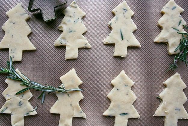 rosemary shortbread cookies shaped like Christmas trees before baking