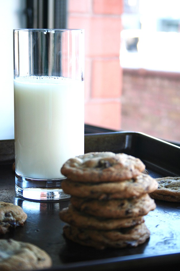 a tall glass of milk is the best pairing for a stack of salted chocolate chunk cookies