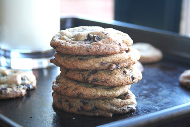 a large stack of salted chocolate chunk cookies